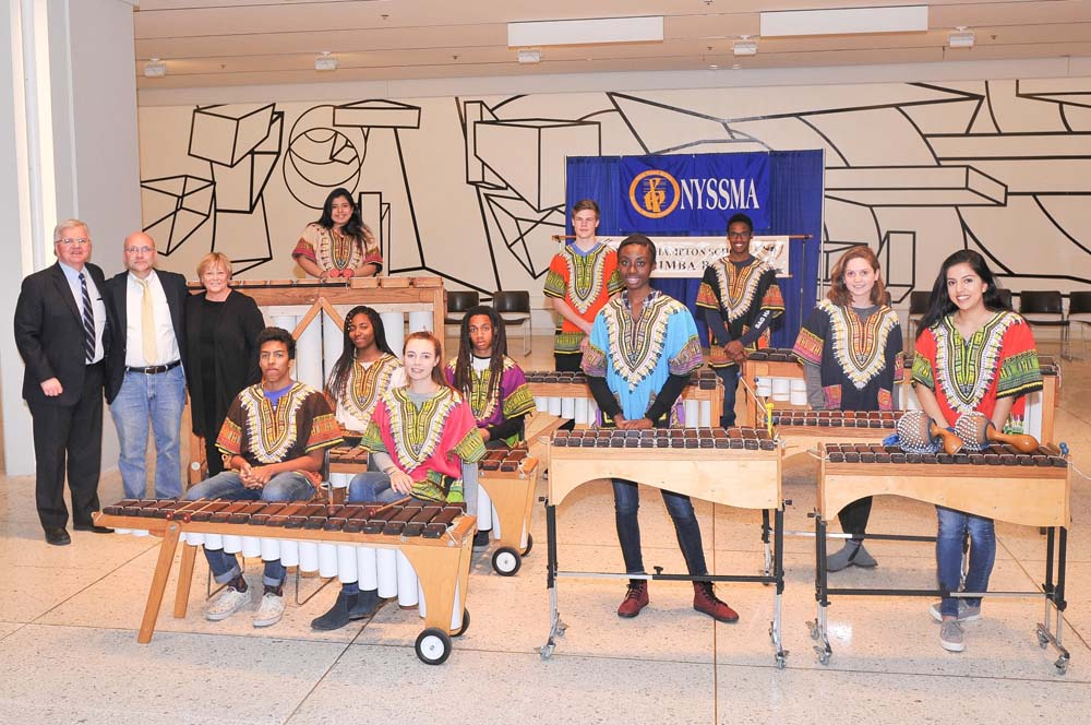 "Assemblyman Fred W. Thiele Jr. welcomed the Bridgehampton School Tewa Marimba Ensemble on Wednesday, March 23, 2016 during their performance on the South Concourse of the Empire State Plaza in Albany in celebration of ""Music in Our Schools Month"" sponsored by the New York State School Music Association (NYSSMA). Pictured with the Assemblyman are David Elliot, Band Director and the Superintendent of the Bridgehampton School District, Dr. Lois Favre. Members of the Tewa Marimba Ensemble: Isaiah Aqui; Autumn Street; Harriet DeGroot; Ameer Brunson; Nia Dawson; Elizabeth Hochstedler; Laura Uribe; Patricia Figueroa; Matthew Hostetter and Michael Smith."