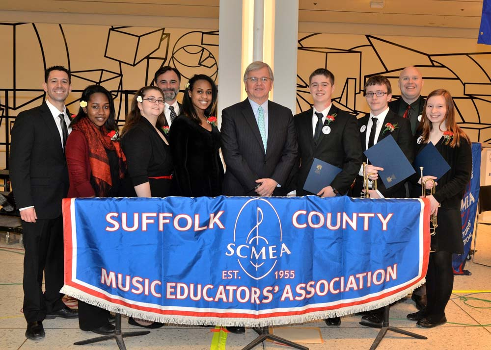 "Assemblyman Fred W. Thiele, Jr. pictured with local high school students who performed with the Suffolk County Music Educators' Association (SCMEA) All-County Instrumental and Vocal Jazz Ensembles on Tuesday, March 3, 2015 on the South Concourse of the Empire State Plaza in Albany in celebration of ""Music In Our School Month"" sponsored by the New York State School Music Association (NYSSMA). Pictured from left to right, Michael Caravello (SCMEA Executive Board, Government Relations Coalition & Music in our Schools Month),  Tia Johnson (Brentwood High School – Alto Voice), Rebecca Engel (William Floyd High School – Soprano Voice), Michael Mastrangelo (SCMEA Executive Board --Government Relations Coalition & Music in our Schools Month),  Sherby Michael (William Floyd High School – Alto Voice), Assemblyman Thiele, Nick Arpino (Westhampton Beach High School – Drum Set), Danny Jones (Riverhead High School -- Trumpet), Phil Voight (SCMEA President), and Lauren Schmitt (Riverhead High School – Trumpet)."