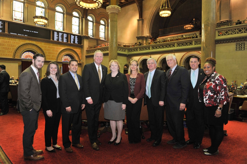 Assemblyman Fred W. Thiele, Jr. (I, D, WF, WE-Sag Harbor) and other members of the New York State Assembly's Suffolk County Delegation, welcomed Suffolk County Legislators Kate Browning and Bridget Fleming to the Assembly Chamber on Wednesday, March 22, 2017 during their visit to Albany to advocate for increased funding for Suffolk County's public transportation system as part of the Long Island Lobby Coalition's sixth annual Lobby Day in Albany. Pictured left to right: Ryan Stanton (Long Island Federation of Labor), Liz Sutton (Office of Suffolk County Legislator Bridget Fleming), Josh Slaughter (Office of Suffolk County Legislator Kate Browning), Assemblyman Michael J. Fitzpatrick, Suffolk County Legislator Kate Browning, Suffolk County Legislator Bridget Fleming, Assemblyman Fred W. Thiele, Jr., Assemblyman Steve Englebright, Assemblyman Anthony H. Palumbo and Assemblywoman Kimberly Jean-Pierre.<br />