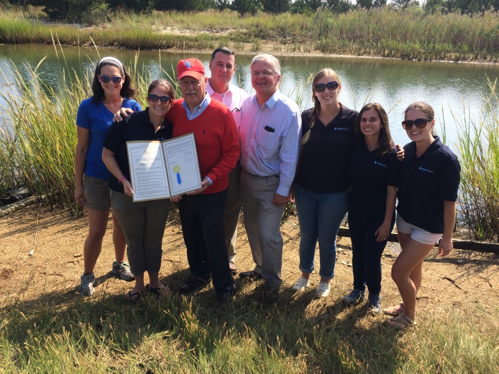 Assemblyman Fred W. Thiele, Jr. (I,D, WF, WE – Sag Harbor) and State Senator Ken LaValle presented the Peconic Estuary Program (PEP) with a Resolution adopted by the State Legislature in 2017 that proclaims September 16−23 as Estuaries Week in the State of New York, in conjunction with National Estuaries Week. The Resolution was presented to PEP during its volunteer Salt Marsh Planting event on September 16, 2017. From left: Adelle Molina, PEP Outreach Assistant; Dr. Alison Branco, PEP Director; Senator LaValle; NYS Assemblyman Anthony Palumbo (back); Assemblyman Thiele; Christie Pfoertner, PEP Outreach Coordinator; Elizabeth Hornstein, PEP State Coordinator; Sarah Schaefer, PEP Program Coordinator.