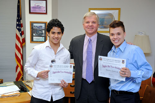 Assemblyman Fred W. Thiele congratulates Angelo Del Toro scholarship recipients Michael Cuenca (left) and Brandon Sandoval (right), East Hampton High School students participating in the Angelo Del Toro Puerto Rican/Hispanic Youth Leadership Institute.