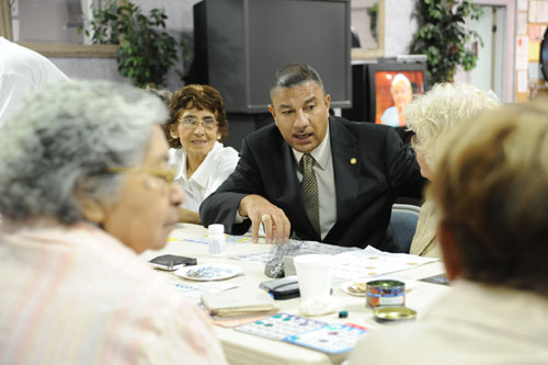 Assemblyman Ramos chats with patrons taking a quick break from their BINGO game at Adelante of Suffolk County, Inc. in Brentwood.