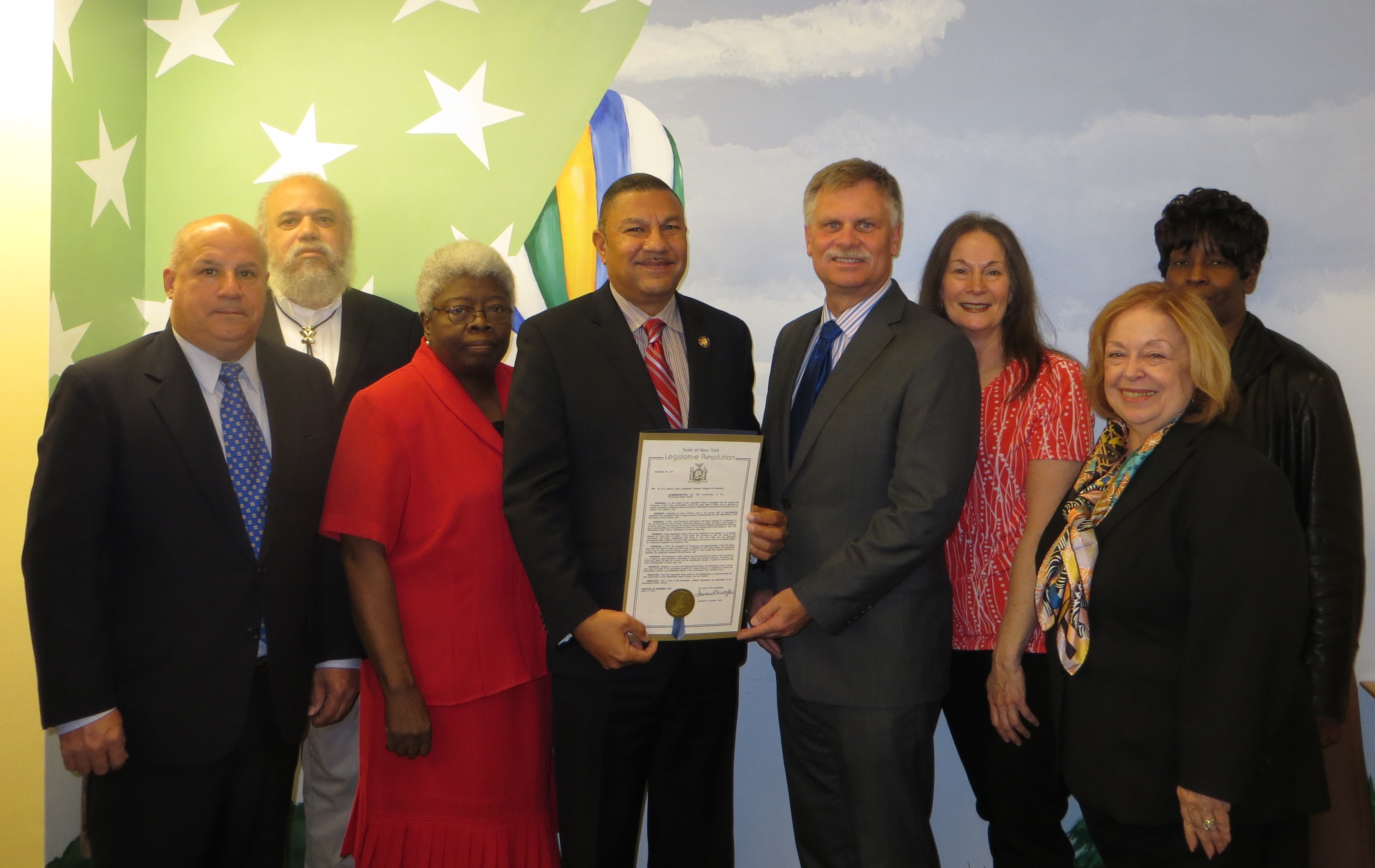 Assemblyman Phil Ramos presents a resolution to the Brentwood Public Library trustees on the commemoration of the library's 76th anniversary.