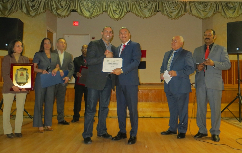 Assemblyman Phil Ramos congratulates Julio Diaz, a Dominican small business owner, who was honored at the Herencia Dominicana event held on February 22, 2015 at the Long Island Portuguese-American Center.