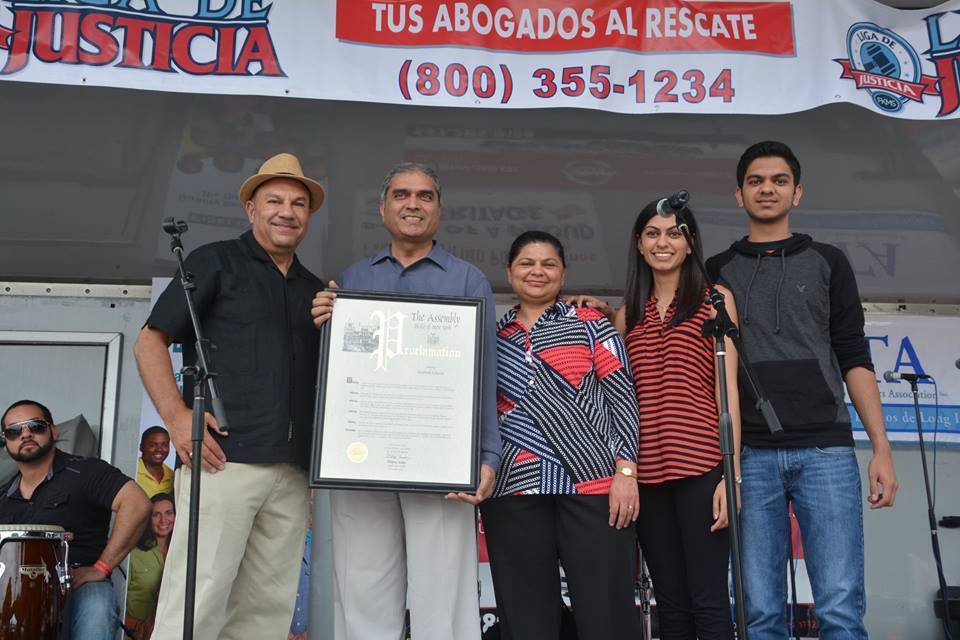 "Assemblyman Ramos honors Bhadresh ""Bob"" Acharya, owner of Brentwood Pharmacy, at the 2015 Brentwood Arts & Salsa Festival."