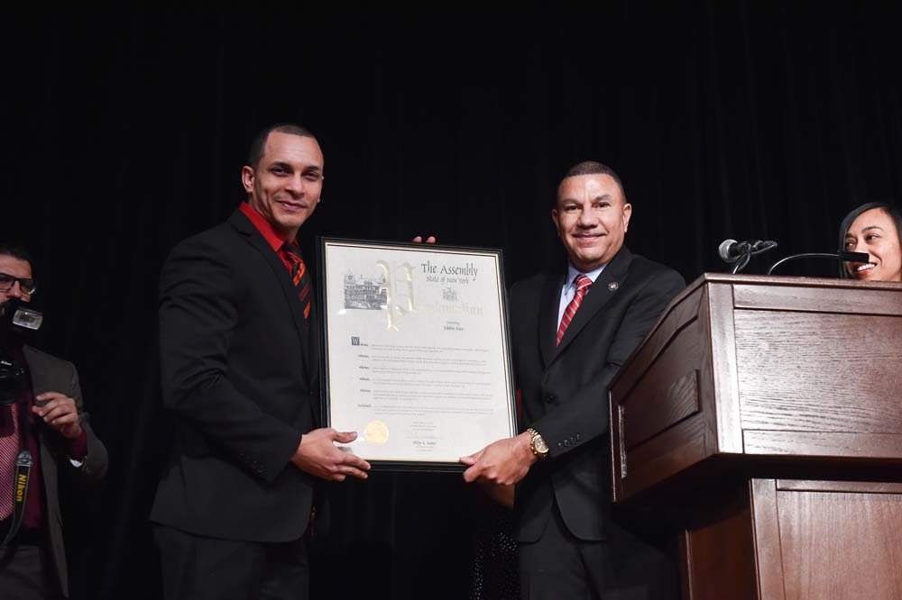 Ramos presents Edhuin Diaz a proclamation during the 4th Annual NYS Association of Black & Puerto Rican Legislators Legislative Conference for his work and contributions to the field of health care.