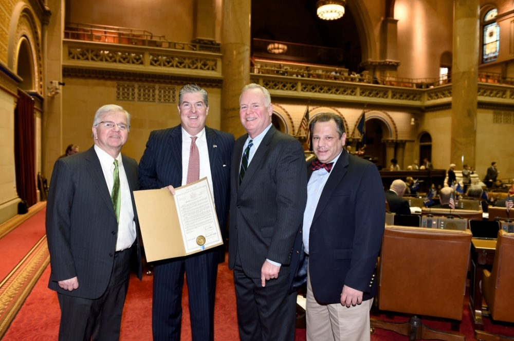 Assemblyman Fred Theile, Jr., Kevin McCrudden of Smithtown, Assemblyman Michael Fitzpatrick (R,C,I-Smithtown), and Assemblyman Andrew Raia (R,I,C-East Northport) take a photo to commemorate the Assembly Resolution that was passed celebrating the 15th anniversary of National Motivation and Inspiration Day, which McCrudden helped to establish.