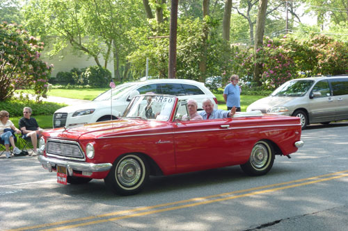 Assemblyman Charles Lavine had a blast riding with Legislator Judy Jacobs in the Plainview-Old Bethpage Memorial Day Parade in a vintage 1961 AMC Rambler American.