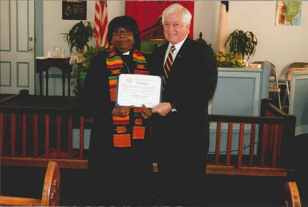Assemblyman Charles Lavine (D-Glen Cove) presents a citation to Reverend Linda Vanager, Pastor of Hood AME Zion Church in Oyster Bay during a special service celebrating February as Black History Month and honoring the ancestry and heritage of African Americans.