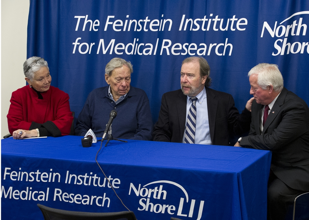 Assemblyman Charles Lavine (D-Glen Cove) right, listens as Dr. Peter Davies, PhD, Director, Litwin-Zucker Research Center for the Study of Alzheimer's Disease makes a point during a press conference Thursday, November 7, at the Feinstein Institute for Medical Research in Manhasset to focus attention on the need for funding for Alzheimer's Research. Joining Dr. Davies and Assemblyman Lavine are Dr. Richard Purdy, 83, and his wife Gloria, who have been married for more than 50 years. Dr. Purdy, a pioneer in vascular surgery, was diagnosed with Alzheimer's disease in 2007 and has been receiving treatment at the Feinstein Institute, part of the North Shore-LIJ Health System. Assemblyman Lavine has sponsored a bill to seek voter approval for a $1 billion bond act to fund Alzheimer's Research. The Alzheimer's Research Bond Act of 2014 will need voter approval to move forward.
