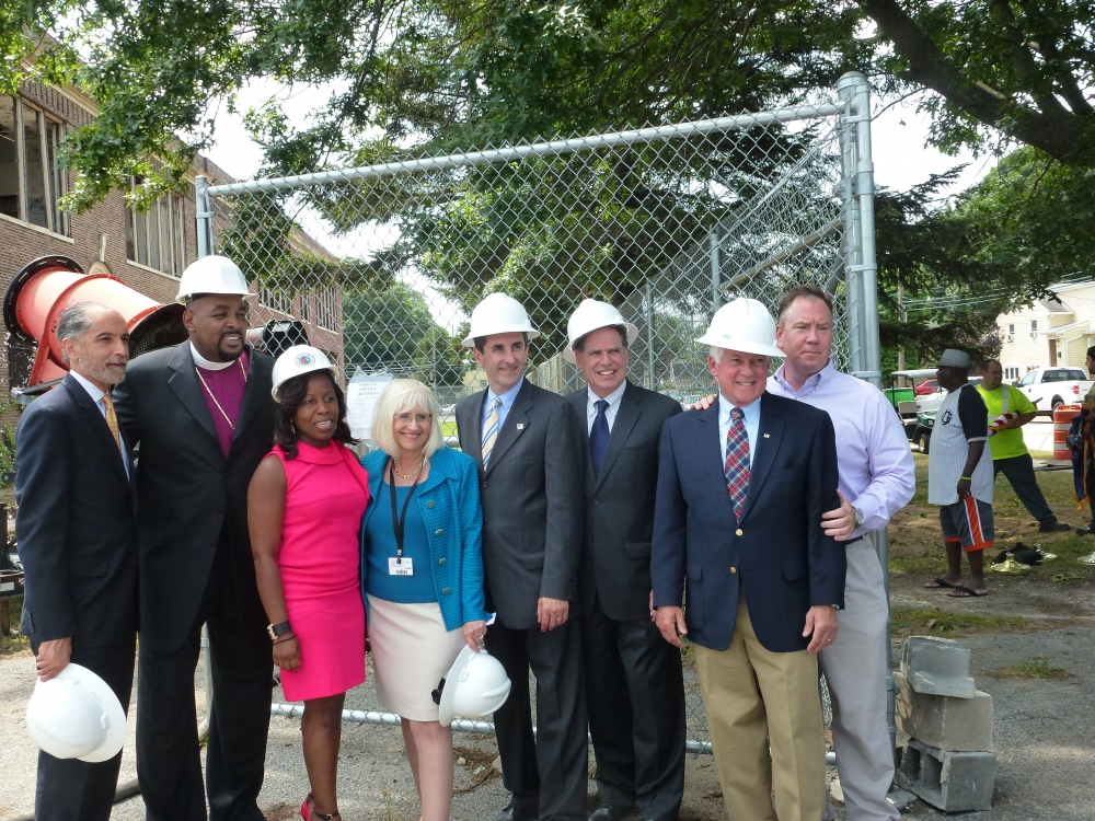 Assemblyman Charles Lavine (D-Glen Cove) second from right, joined officials from the Town of North Hempstead at the demolition of the Grand Street School in New Cassel. The school, which has been vacant for several years and had become an eyesore, will be replaced with townhouses for senior citizens. Town of North Hempstead officials, from left, Deputy Supervisor Robert Troiano, Revenue Lionel Harvey, Councilwoman Viviana Russell, Supervisor Judi Bosworth, Town Clerk Wayne Wink, Town Tax Receiver Charles Berman and Sean Rainey, Executive Director of the Housing Authority.