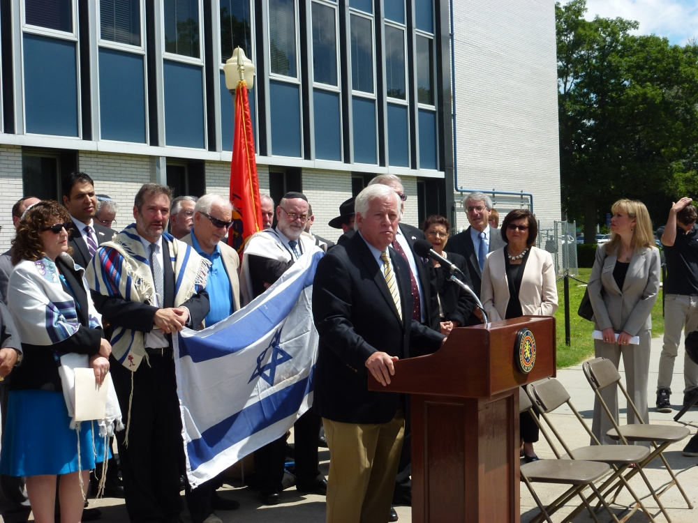"Assemblyman Charles Lavine, center, addresses the crowd that came together for the Jewish Community Relations Council's solidarity rally for three Israeli teenagers – Eyal Yifrah, Gilad Shaer and Naftali Frenkel-  kidnapped by terrorists two weeks ago and their families. The event held on the steps of the Nassau County Human Rights Commission, brought together members of the Long Island community, religious leaders and public officials who condemned the abduction and offered prayers for the safe return of the young teens. Their cry to ""Bring Back Our Boys"" was repeated throughout the rally."