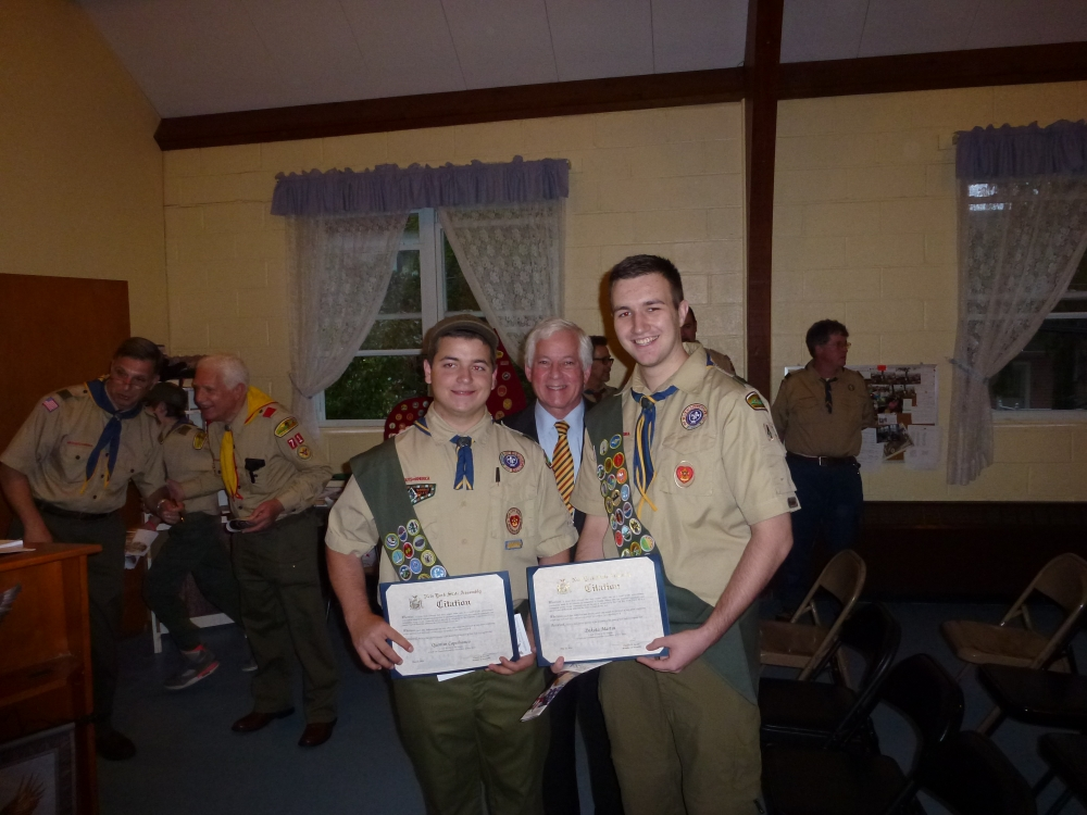 Assemblyman Charles Lavine (D-Glen Cove) presents Quentin T. Capobianco, left, and Dakota J. Martin with citations at their Eagle Court of Honor held at St. Luke's Episcopal Church in Sea Cliff on May 22. The Eagle Scouts, who are members of Troop 43, were recognized for their accomplishment in earning their Eagle Scout badges. Assemblyman Lavine spoke at their induction commending them on their hard work and dedication in earning this honor.