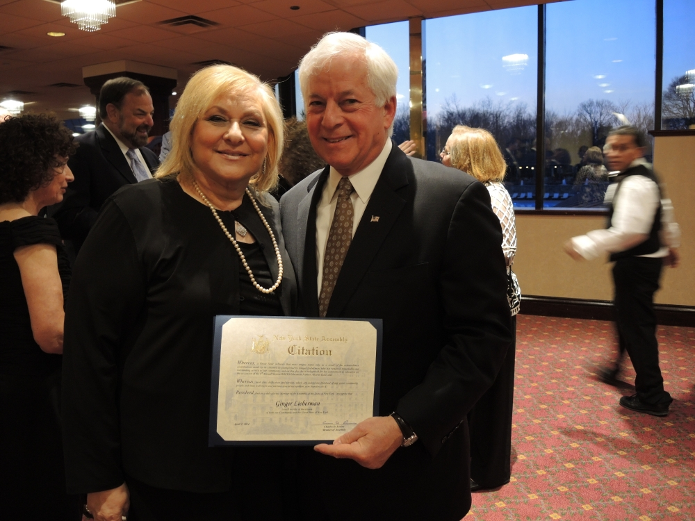 "Assemblyman Charles Lavine, left, presents Ginger Lieberman, President of the Plainview-Old Bethpage Board of Education with a citation during the 2014 Nassau BOCES Education Partner Awards dinner at the Crest Hollow Country Club in Woodbury. The event recognizes the ""Most Influential People for Public Education in Nassau County"" annually. Categories include Education Partners, Nassau BOCES Employees, Organizations, School Board Members, Students and Teachers. Recipients were chosen for the honor from among dozens of nominees by a committee of distinguished educators and community leaders who identified individuals and organizations who personified the spirit of educational partnerships and had a measurable impact on public education in Nassau County."