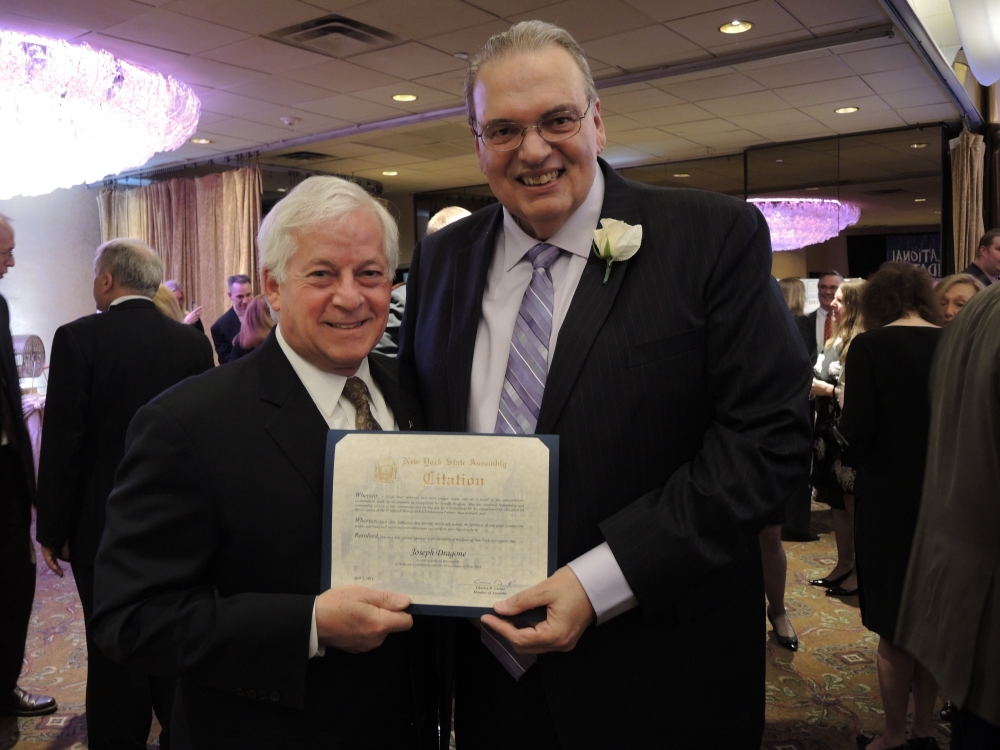 "Assemblyman Charles Lavine, left, presents Joseph C. Dragone, Assistant Superintendent for Business for the Roslyn School District with a citation during the 2014 Nassau BOCES Education Partner Awards dinner at the Crest Hollow Country Club in Woodbury. The event recognizes the ""Most Influential People for Public Education in Nassau County"" annually. Categories include Education Partners, Nassau BOCES Employees, Organizations, School Board Members, Students and Teachers. Recipients were chosen for the honor from among dozens of nominees by a committee of distinguished educators and community leaders who identified individuals and organizations who personified the spirit of educational partnerships and had a measurable impact on public education in Nassau County."