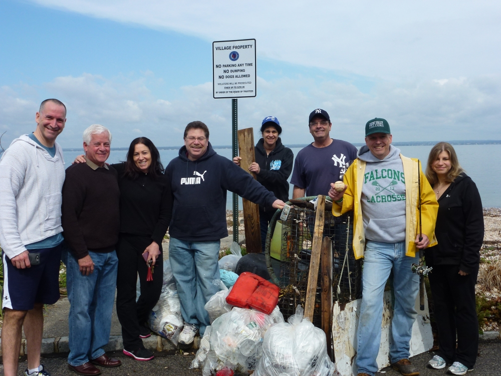 Assemblyman Charles Lavine, second from left, joined the Oyster Bay Democrats at Merritt Lane Beach in Bayville recently to perform a clean-up in conjunction with the Friends of the Bay's Bay Clean-up. Each spring, members of the OB Democrats select a beach and head out to clear debris that has accumulated during the winter months. Helping out were from left, Adam Haber, Candidate for 7th Senate District, Chuck, Joe Lorintz, Candidate for Family Court, County Court Judge Tammy Robbins, Marissa Lorintz, Dan Milano, Dave Gugerty, Town Leader, Linda Dunkel.