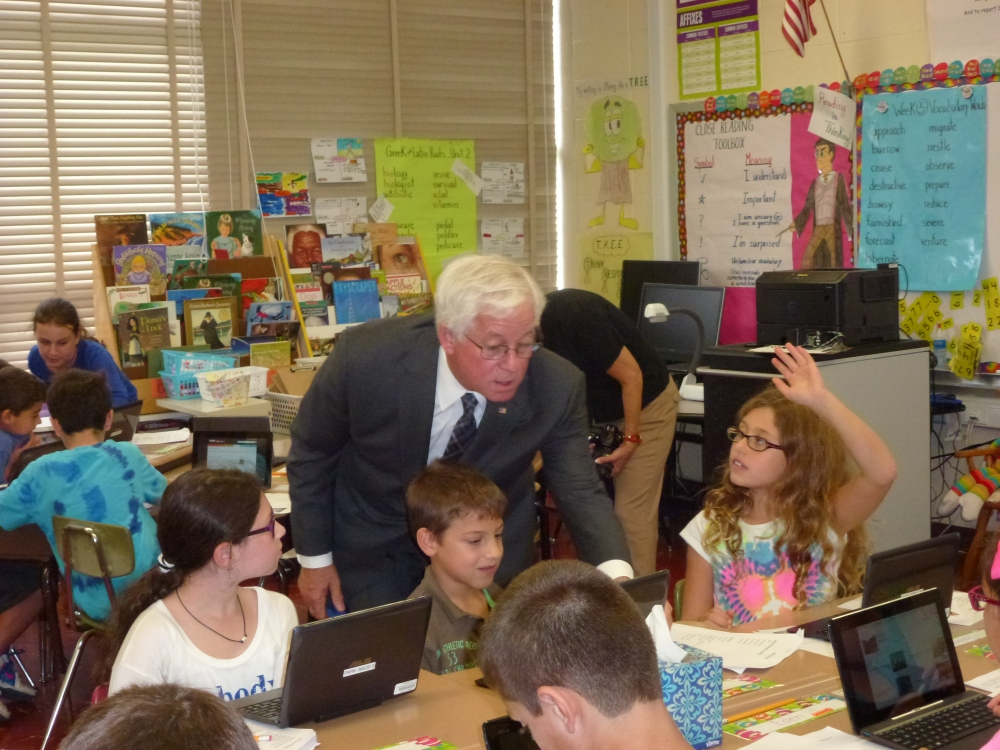 Assemblyman Charles Lavine (D-Glen Cove) talks to students in a fourth grade class at Parkway Elementary School in Plainview who are working with wireless tablets to conduct research for an assignment. The 30 wireless tablets, security charging cart and software for the tablets were purchased with part of a $50,000 grant to the Plainview-Old Bethpage School District secured by Assemblyman Lavine.