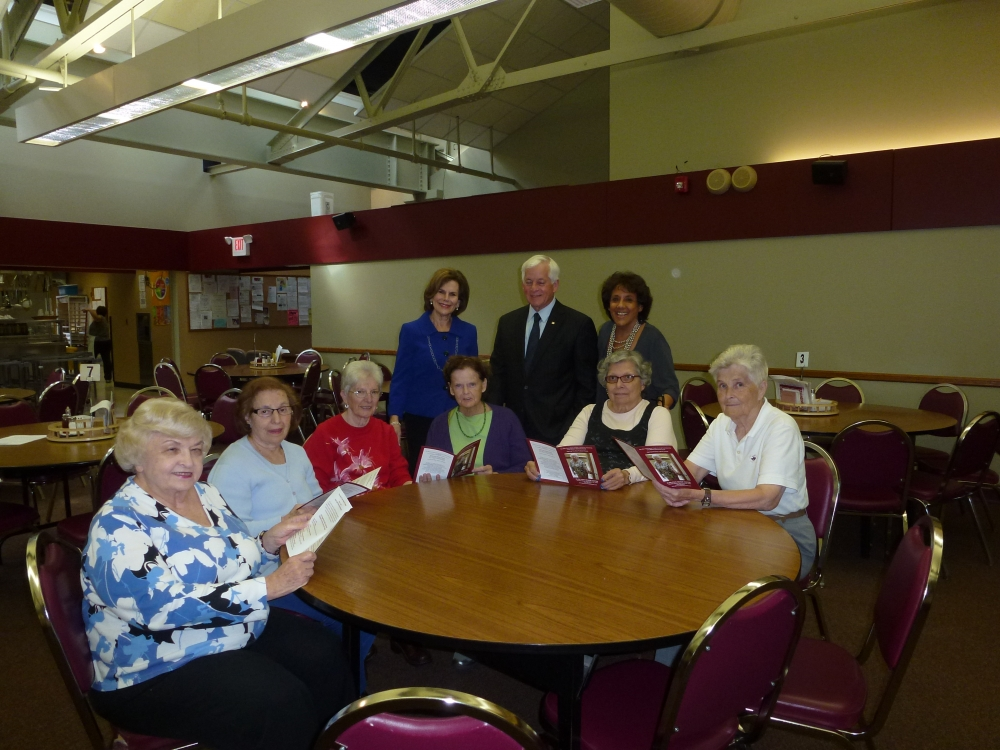 Assemblyman Charles Lavine (D-Glen Cove) joined Carol Waldman, to his right, Executive Director of the Glen Cove Office of Senior Services, and Lorraine Greenberg, to his left, Project Coordinator, during a visit to the Glen Cove Senior Center. Volunteers at the Center look over a new brochure for the Gray Matters Workshop Series – Opening the Door to Brain Fitness that was developed with funding from a $12,000 grant secured by Assemblyman Lavine. The grant was used for quality of life programs, including educational, recreational and social programs for seniors.