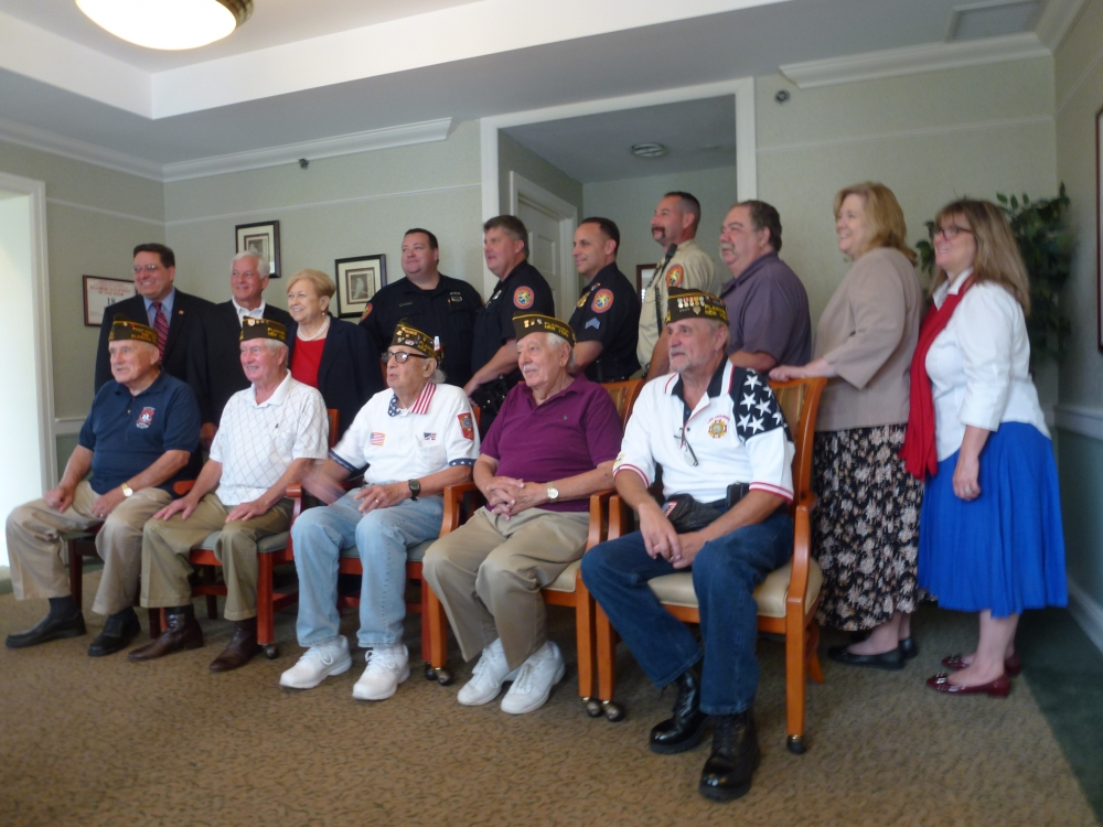 Assemblyman Charles Lavine (D-Glen Cove) second from left, participated in the Atria Senior Living Salute Our Heroes event this week at the senior facility in Plainview. Each year, Atria residents and staff recognize first responders for their efforts on behalf of the community with a brunch and musical entertainment. This year, seniors sang a series of patriotic songs to salute local responders on Patriots' Day. Joining Assemblyman Lavine was Plainview Water District Commissioner Andrew Bader, left, and Nassau County Legislator Judy Jacobs. Atria staff included Nancy Weblock, Engaged Life Director and Sharon Hayes, Executive Director of Atria, right. Veterans from VFW 5942 included: Peter McCann, Joe Ciaccio, Rocco Figalora, Gene Robinson, and Tom Fahrenholz. Responders from Nassau County Police Department Headquarters at 1490 Franklin Avenue, who were recognized, are: PO Hurtle, PO Taggart, and Sgt. Arnold. Bill Mayo, Chaplain of the Plainview Fire Department was recognized as well as Rob Freedman, NCPD AMT paramedic.