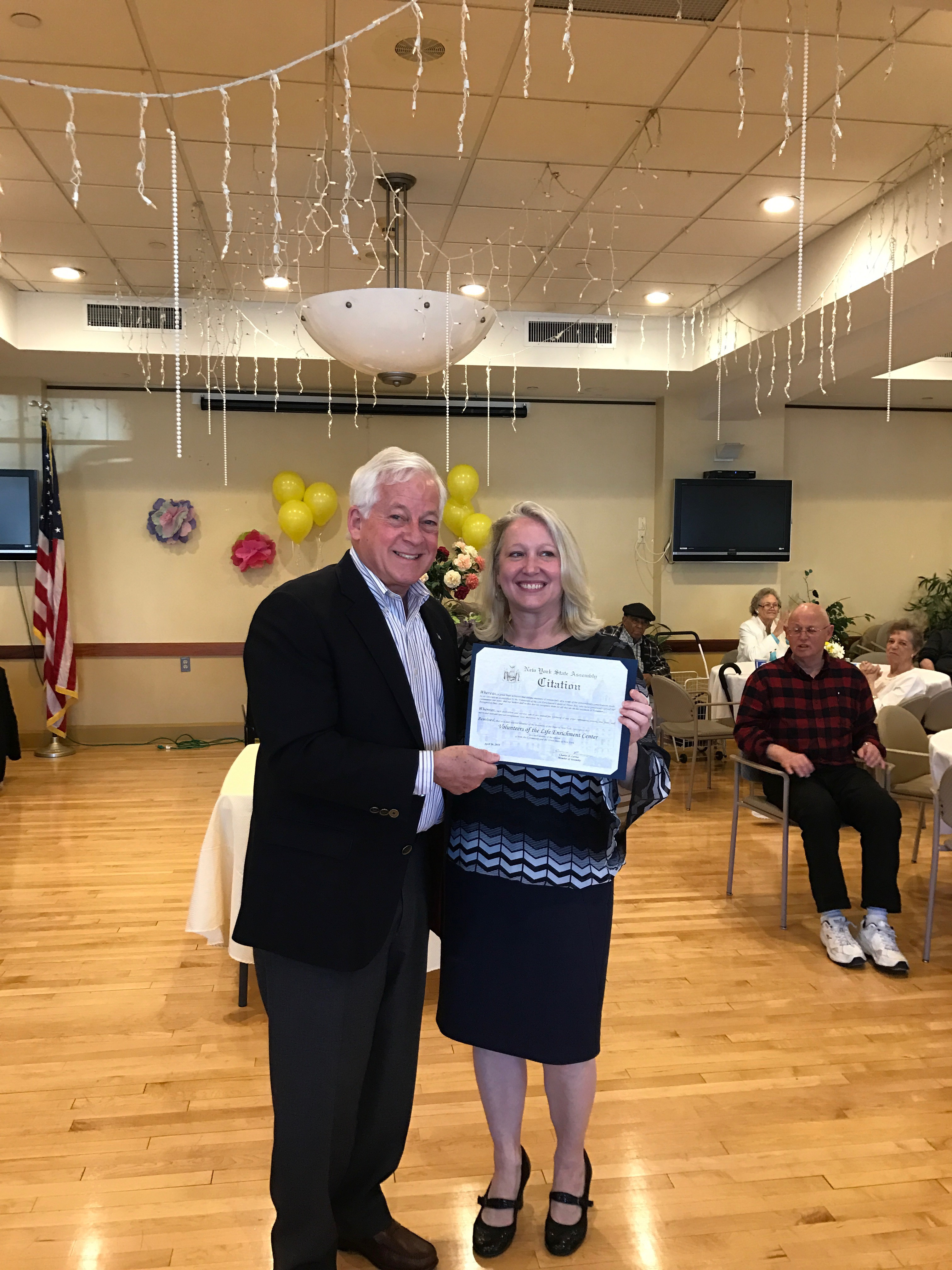 Assemblyman Charles D. Lavine (D-Glen Cove) was pleased to stop by The Life Enrichment Center at Oyster Bay&#39;s annual Volunteer Recognition Day.<br><br>&#34;It was an honor for me to present Judy Palumbo with a citation recognizing all of the wonderful volunteers that help make the Life Enrichment Center one of the best senior citizen centers in my district.&#34; said Lavine.<br><br>Pictured are Assemblyman Charles Lavine and Judy Palumbo, Executive Director of The Life Enrichment Center at Oyster Bay.