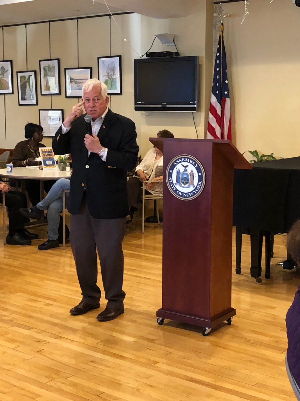 Chuck speaks at his Senior Scam event in OB