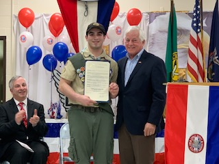 Assemblymember Lavine presents a citation to Eagle Scout, Timothy Patrick Dyfnog Rea of Troop 170 in Syosset.