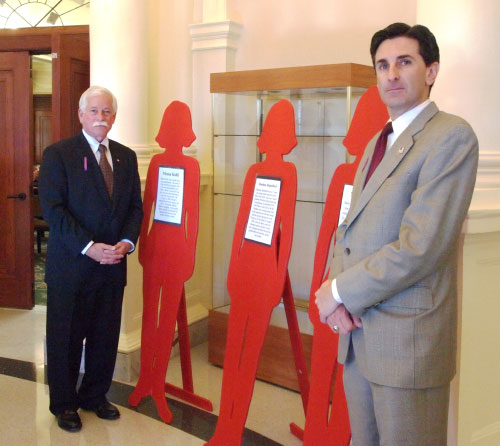 "To recognize October as Domestic Violence Awareness Month, Assemblyman Charles D. Lavine joined Nassau County Legislator Wayne Wink at a somber memorial ceremony for victims of domestic violence held at the Nassau County Theodore Roosevelt Legislative and Executive Building. The event featured life-sized cutouts to represent murdered women; each cutout included the victim's story. Assemblyman Lavine said, ""I commend the Nassau County Coalition Against Domestic Violence and the Nassau County Family Violence Task Force both for sponsoring this event and for their continued work in empowering victims of domestic and sexual assault and in changing the social systems that tolerate and perpetuate such abuse."""