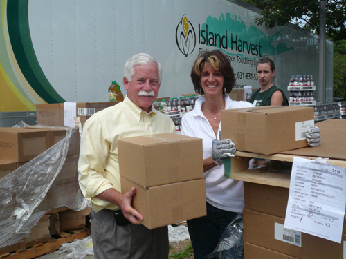 On Thursday, July 16 Assemblyman Charles Lavine joined volunteers of Island Harvest's third Summer Food Blitz where the group sorted, packaged and transferred approximately 500,000 pounds of donated food to more than 100 local agencies and food pantries for further distribution to persons in need. Pictured with Assemblyman Lavine is Randi Shubin Dresner, president and CEO of Island Harvest.