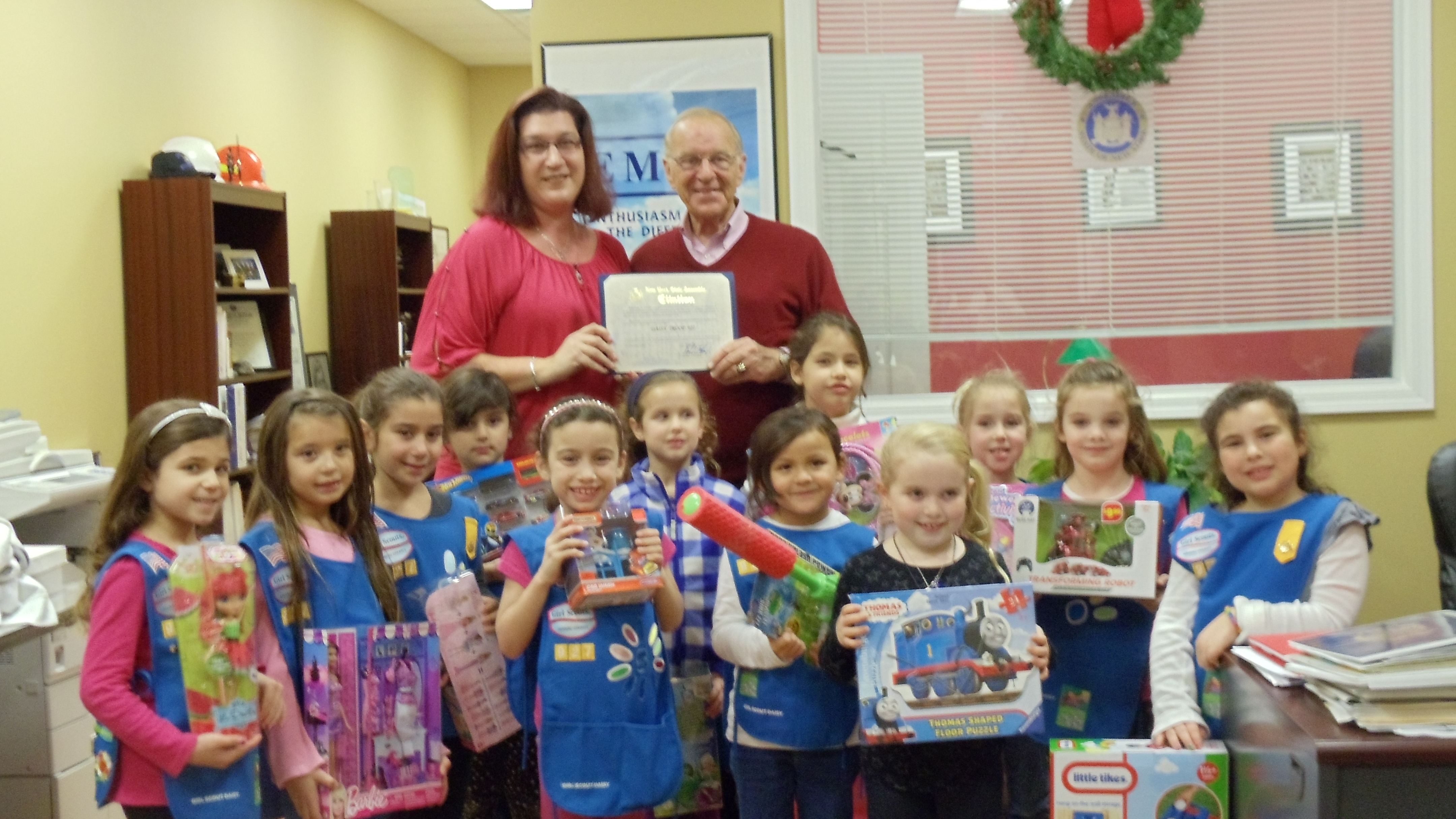 Assemblyman Dave McDonough presents an Assembly Citation to Daisy Troop 927, led by Maria Kotanidis, for their support of Toys for Tots.