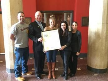 Assemblyman Dave McDonough presents an Assembly Proclamation to Chris Patten and Jacqueline Geller, social studies teachers at Mepham High school; Amanda Jacobs, a member of the Wellington C. Mepham High School Class of 2014; and Robyn Einbinder, the Chairwoman of the social studies department at Mepham High School.