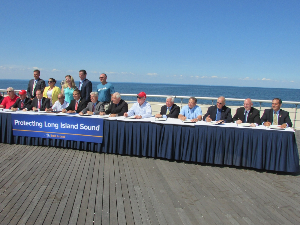 Assemblyman Dave McDonough (R,C,I-Merrick), pictured third from right, joins Governor Cuomo, state and federal representatives and environmental activists to pen a letter to President Obama threatening to sue if Long Island Sound becomes a dumping site for dredged material.<br />