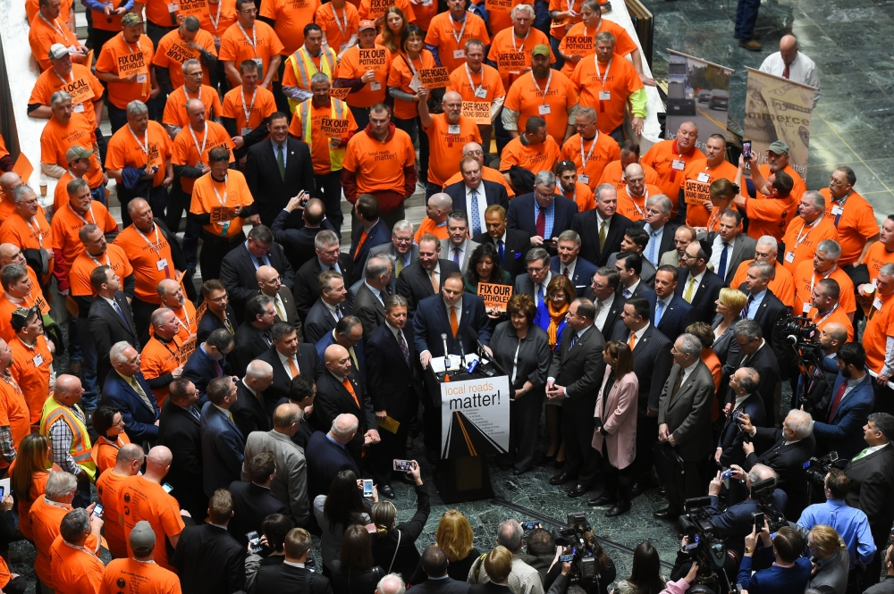 A group of legislators and construction crews from across the state joined together to call for increased CHIPS and PAVE-NY funding at a rally in Albany Wednesday.<br />