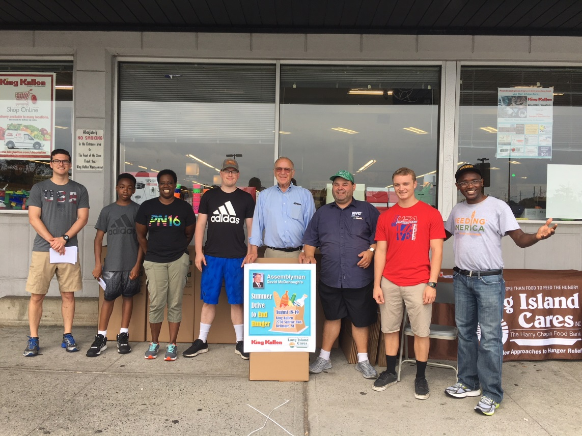 Assemblyman Dave McDonough [center] collects donations for needy families at King Kullen with volunteers from Long Island Cares.