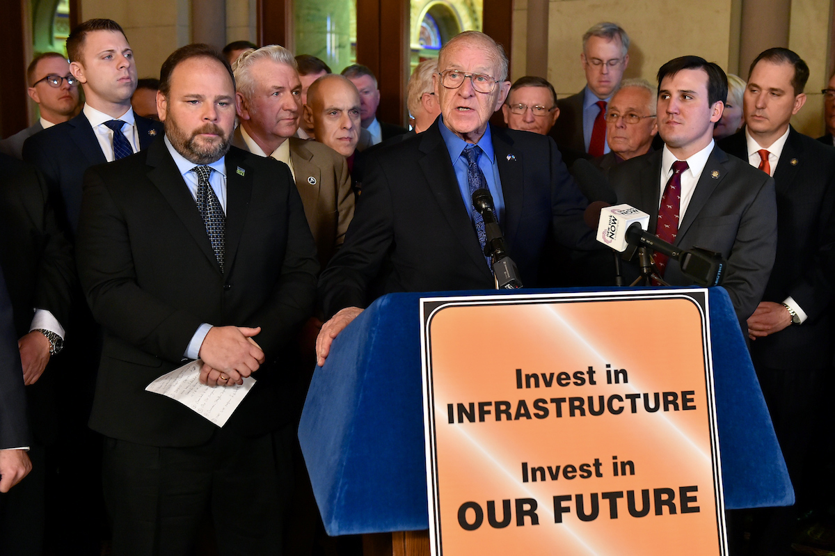 Assemblyman Dave McDonough [at podium] speaks at today's infrastructure investment press conference