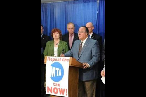 Assemblyman Michael Montesano (at podium) calls for immediate action to end the job-killing MTA payroll tax at a press conference held on June 22, 2011.