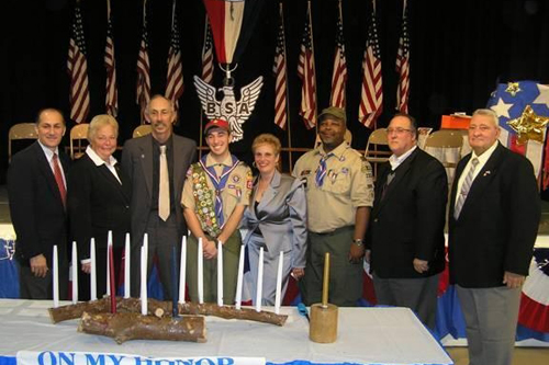 Pictured, here, left to right, are Westbury Mayor Peter I. Cavallaro, Rose Walker, Joey Marcus and his parents, Scoutmaster Dwayne Cox, Assemblyman Michael A. Montesano, and Joe Pascarella.