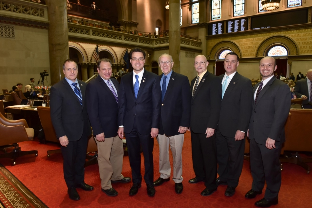 (Left to right): Assemblymen Brian Curran, Andrew Raia, John Mikulin, Dave McDonough, Dean Murray, Anthony Palumbo and Andrew Garbarino in the New York State Assembly Chamber during Mikulin's fir