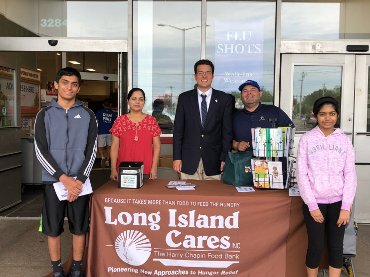 Vidya Thandarath, her children, Assemblyman John Mikulin and Errol Parker pictured during the food drive at King Kullen.