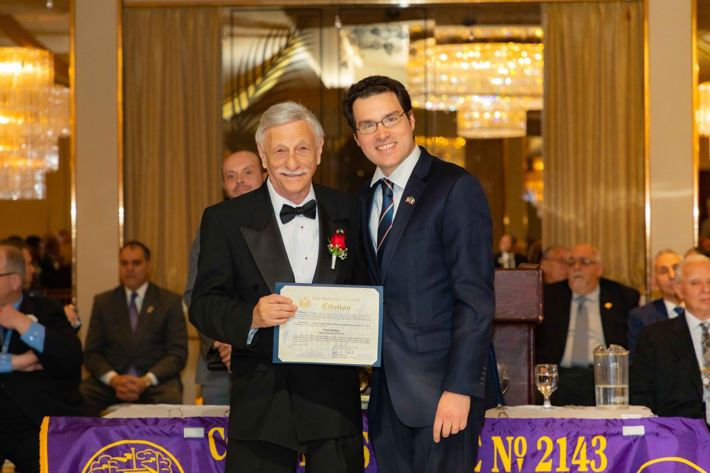 Assemblyman John Mikulin (R,C,I-Bethpage) presents Fred Bellise, outgoing president of the Sons of Italy Columbus Lodge 2143, with a citation at their installation ceremony on Sunday, March 1 at the R