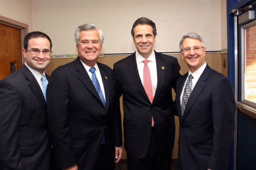 Assemblyman Ra joins Governor Cuomo, State Senate Majority Leader Skelos, and Superintendent of West Hempstead Schools John Hogan to sign legislation that repeals and reduces the MTA payroll tax.