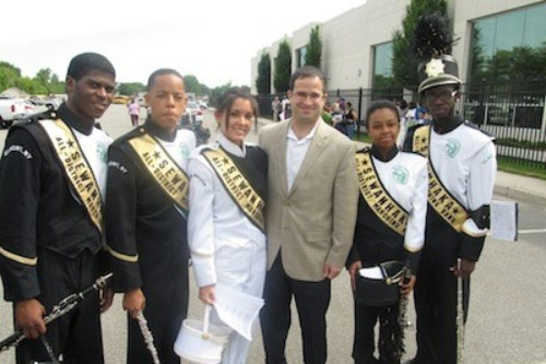 Assemblyman Ra marches with the Sewanhaka High School marching band during Elmont Community Day!