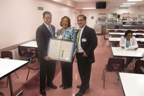 Assemblyman Ra presents a Legislative Resolution to Franklin Square General Hospital in recognition of Nurses Week in New York State. Joining Ra are Barbara Popkins, RN, Associate Executive Director, Patient Care Services; and Franklin Square General CEO Joseph Manopella.