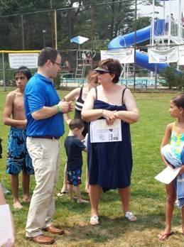 Assemblyman Ed Ra and a local resident discussing the events at Family Safety Day.