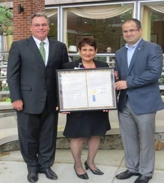 Assemblyman Ed Ra presents a Legislative Resolution to Winthrop-University Hospital. Pictured left to right are John Collins, CEO; Valerie Terzano, Chief Nursing Officer, Winthrop Hospital; and Assemblyman Ed Ra.