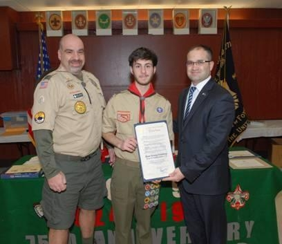 Assemblyman Ed Ra joins Scoutmaster Charles Gripaldi and Eagle Scout Ryan George Goldberg.