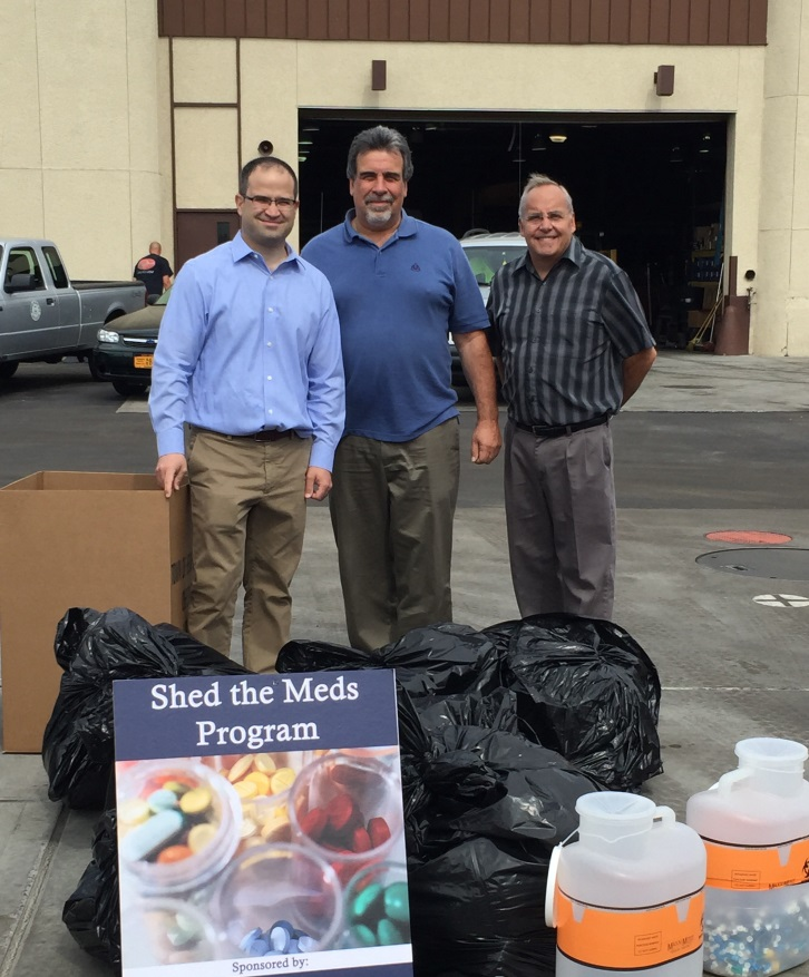 Assemblyman Ed Ra, Commissioner Gaetano Mauro and Commissioner Jeffrey B. Hasselbring Sr. assist with the collection and proper disposal of unwanted medications at the Shed the Meds event that took place on September 27, 2015 at Sanitary District No. 6.