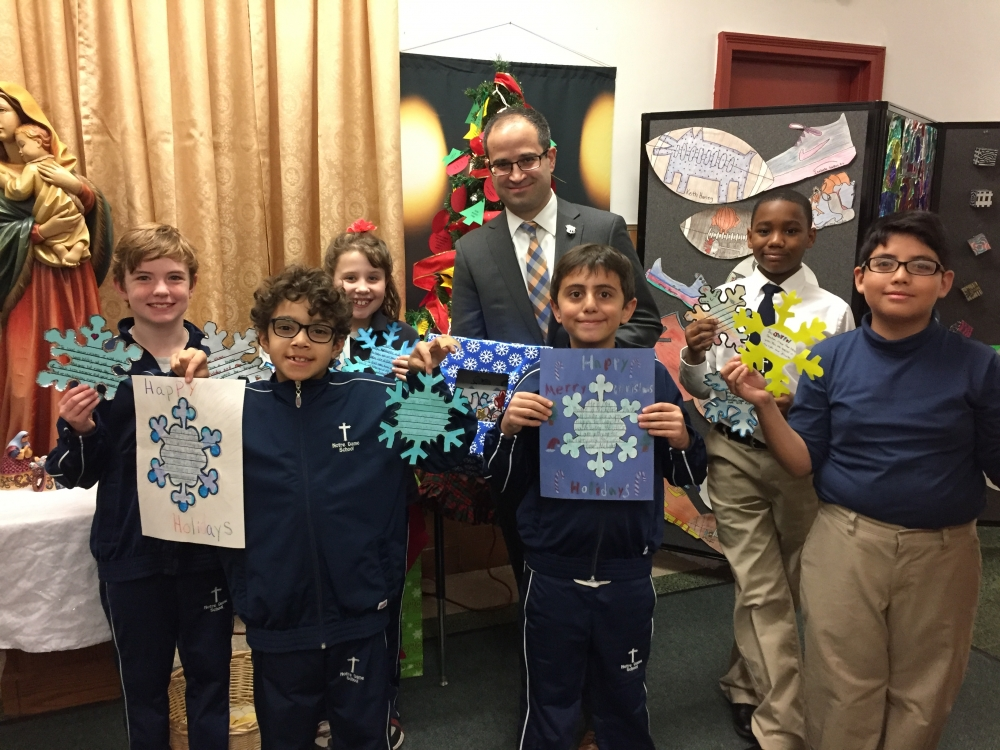 The attached photos depict Assemblyman Ed Ra (R-Franklin Square) with third, fourth and fifth graders of Notre Dame School in New Hyde Park and residents of The Plattduetsche Home Society in Franklin