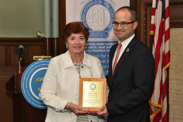 Assemblyman Ed Ra (R-Franklin Square) receiving the 2017 Award of Merit from Dr. Bernadette Happen, Chairwoman of the 4201 Schools Association