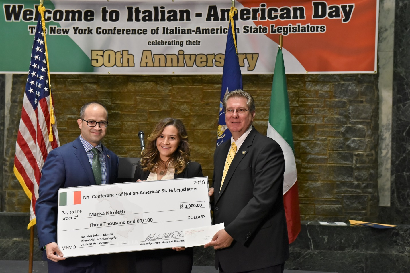 Assemblyman Ed Ra (R-Franklin Square) and Assemblyman Michael DenDekker (D-East Elmhurst) presented Marissa Nicoletti with a check for a $3,000 scholarship from the New York Conference of Italian-Amer
