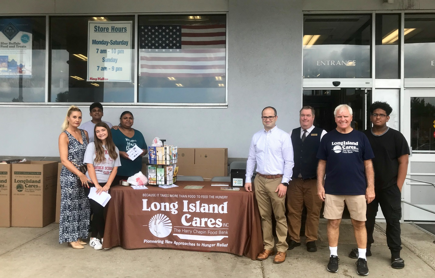 (From left to right) Volunteers Suren Aromogan (back), Meena Armogan (back), Nuria Angos (front), Sofia Carter (front), Assemblyman Ed Ra (R-Franklin Square), Bud Stengren, King Kullen store manager,